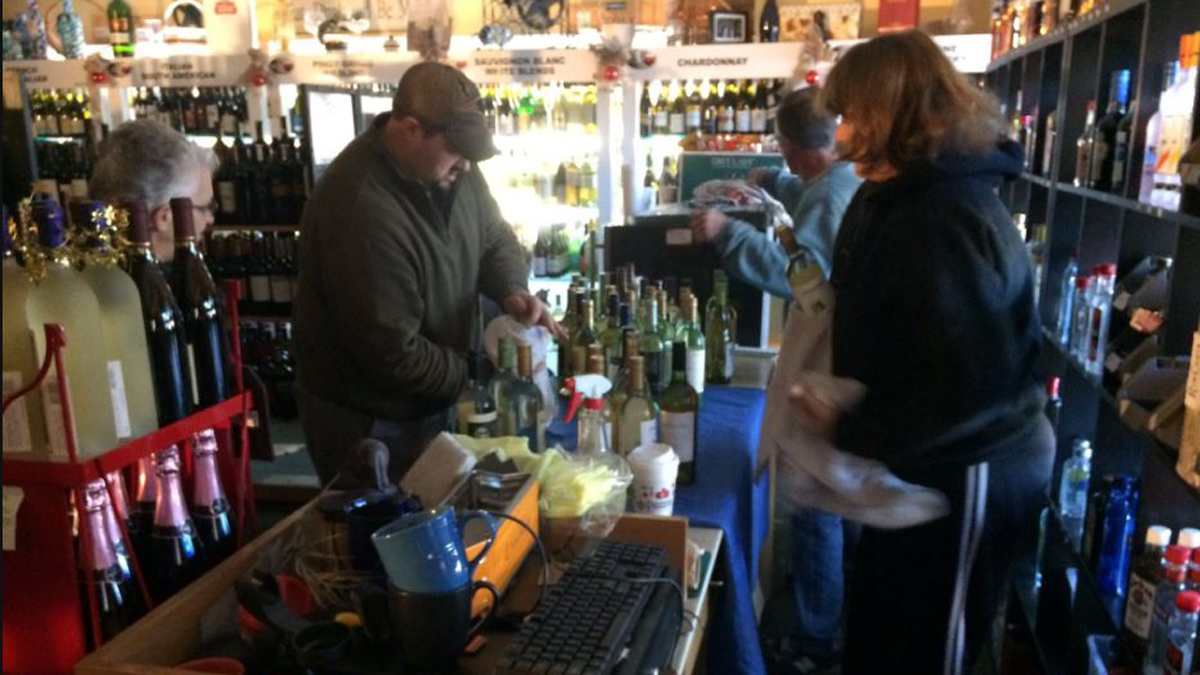 Volunteers came to Cindy's Wine and Spirits on Boston Post Road in Westbrook to help the owners clean up and rebuild after the store was damaged by fire.