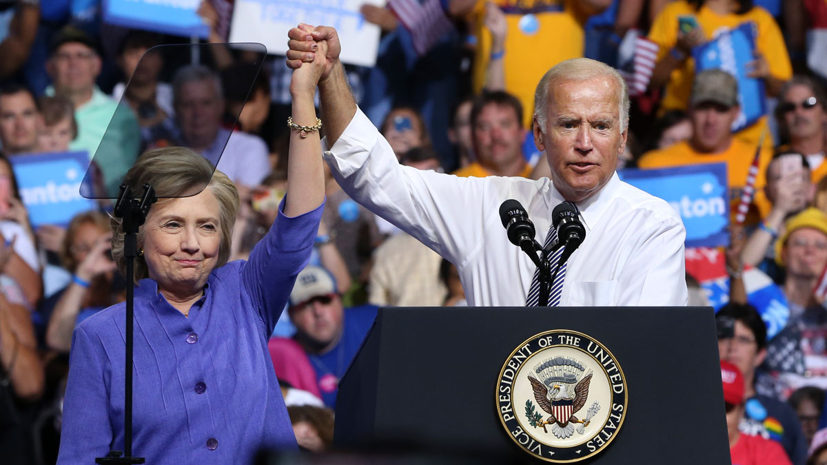 Democratic presidential candidate Hillary Clinton and Vice President Joe Biden hold hands in the air during a campaign rally, on Aug. 15, 2016, in Scranton, Pennsylvania. NBC News confirmed that Clinton's campaign is considering Biden as Secretary of State if she wins.