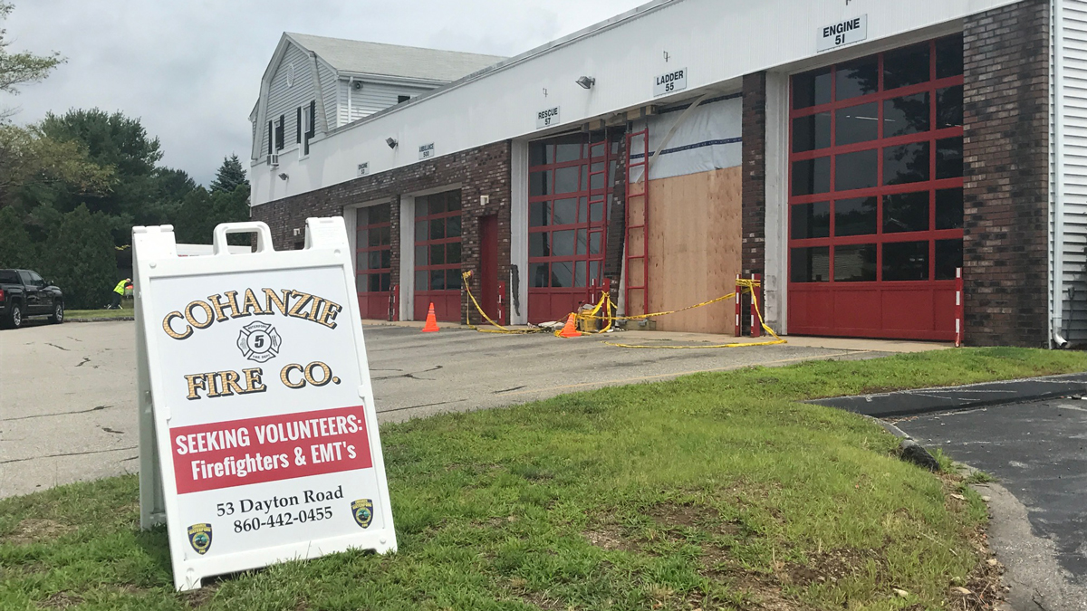 A Cohanzie Fire Company aerial ladder truck is out of commission and the fire company's building damaged after a firefighter accidentally backed the truck into building Sunday night, according to Waterford Police.