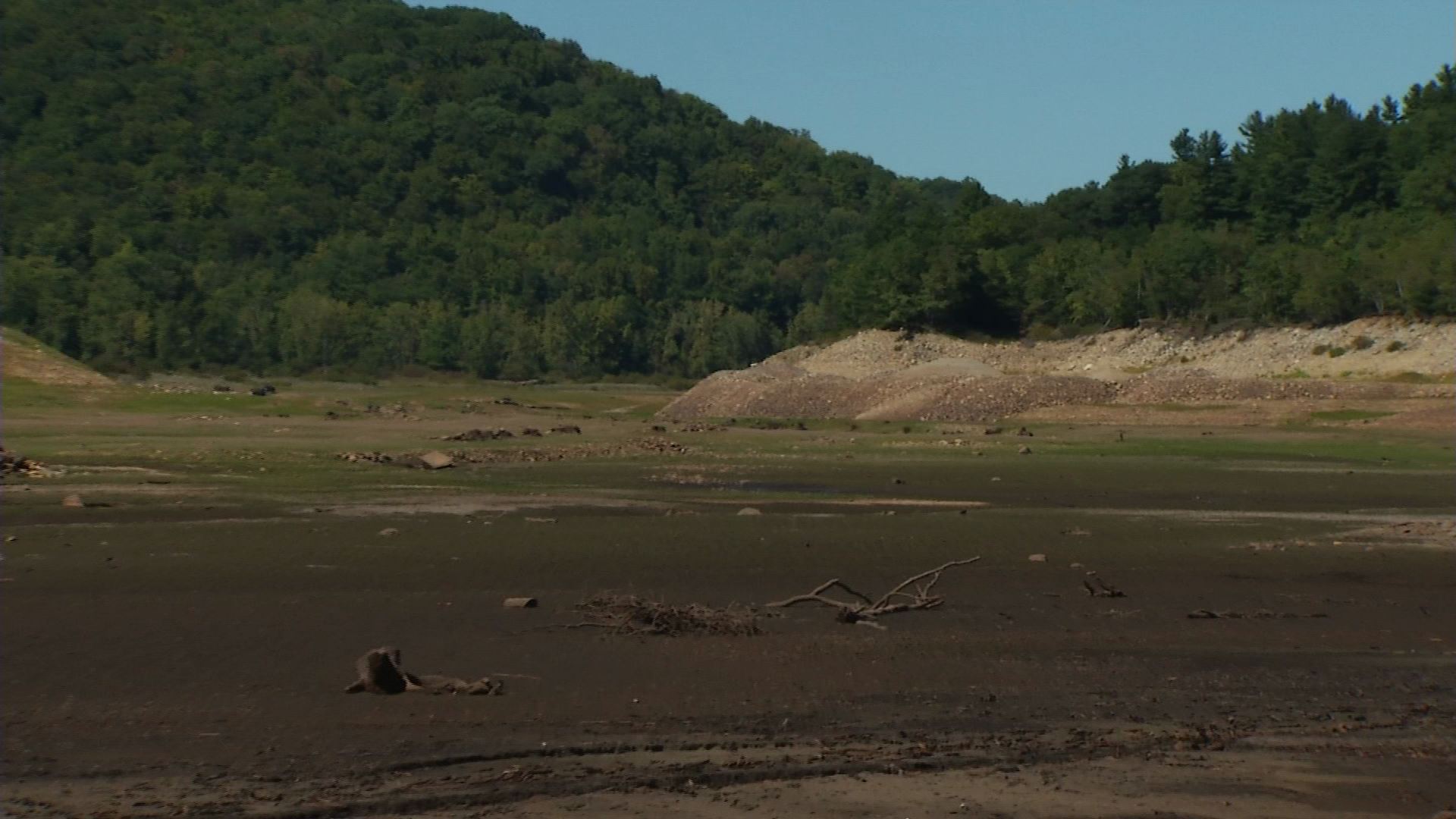 Mud is visible on the floor of the Colebrook River Lake in Colebrook, where the drought's impact is easily visible.
