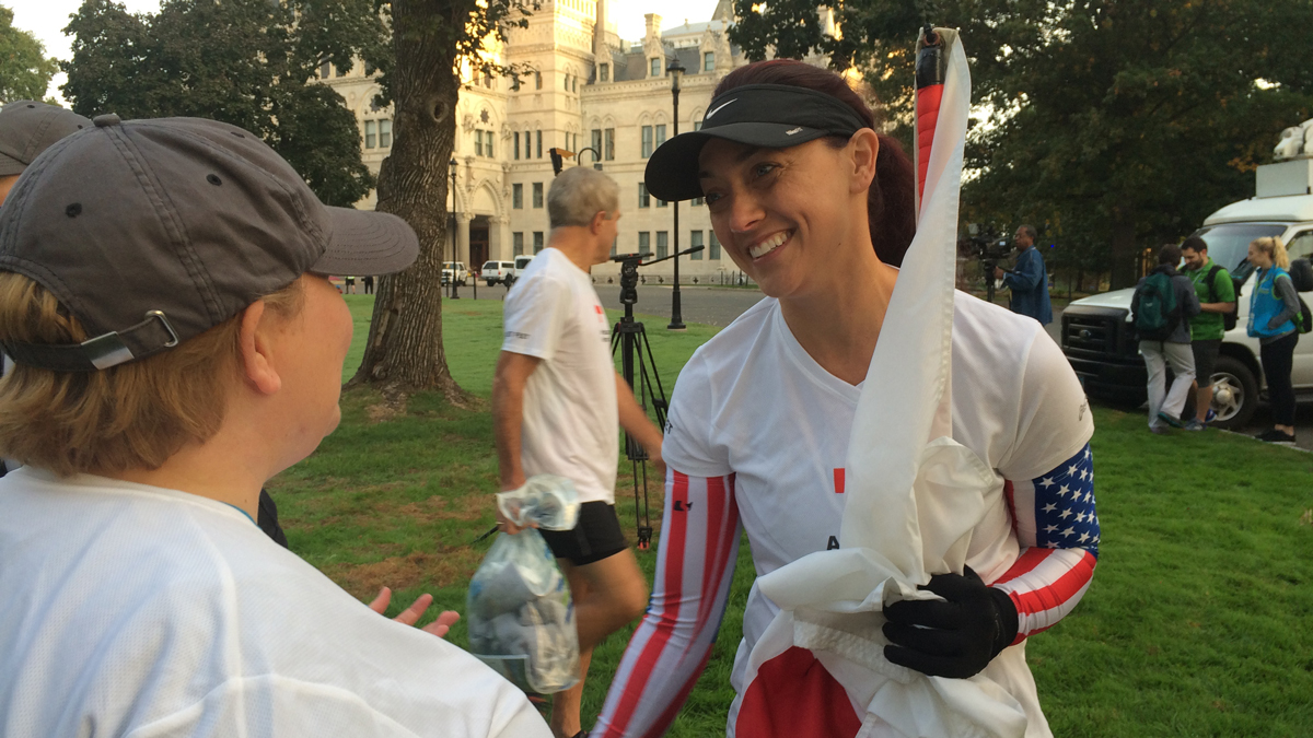 Colleen Alexander of Madison carried the American Red Cross flag in the 23rd Eversource Hartford Marathon on Saturday.