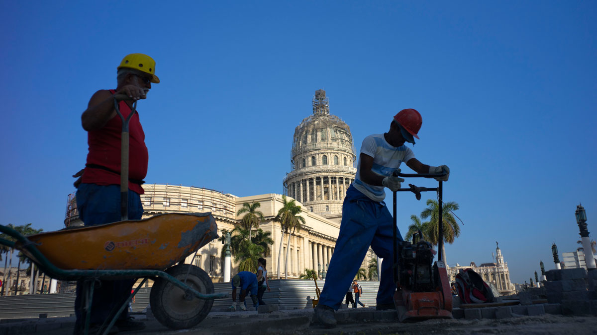 Workers repair the street in front of the Capitolio in Havana, Cuba, ahead of U.S. President Barack Obama's visit on March 20.