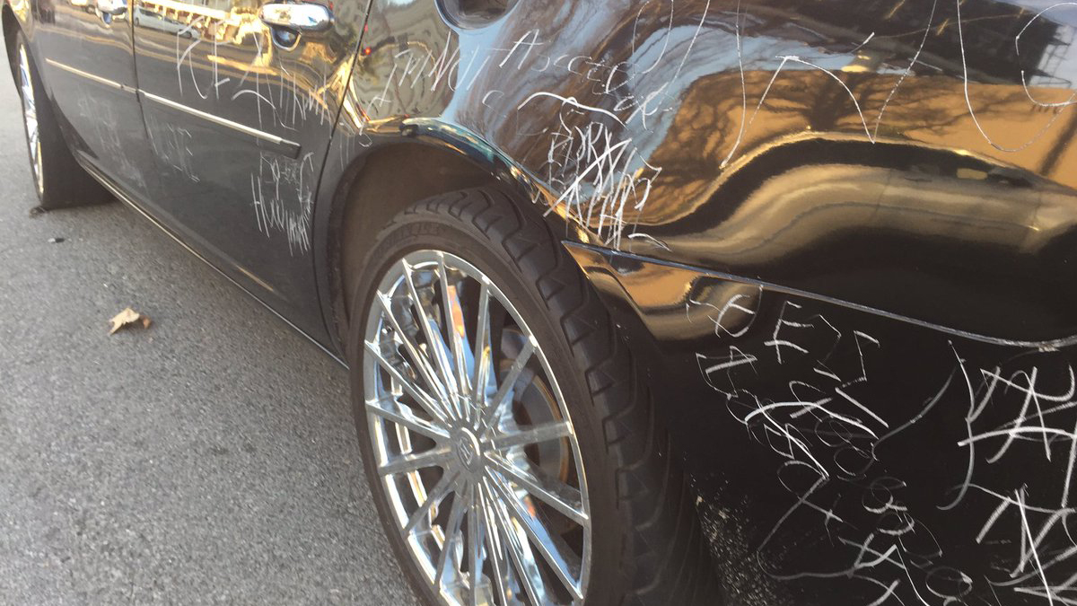 A woman was caught on camera etching and scraping hundreds of words on a car in East Hollywood for at least seven hours on Thanksgiving Day, Thursday, Nov. 24, 2016.