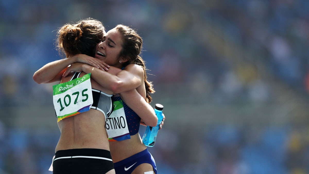 Abbey D'Agostino of the United States (R) hugs Nikki Hamblin of New Zealand after the Women's 5000m Round 1 - Heat 2 on Day 11 of the Rio 2016 Olympic Games at the Olympic Stadium on August 16, 2016 in Rio de Janeiro, Brazil.