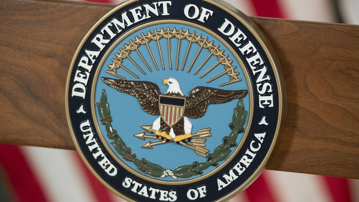 In this Nov. 28, 2016, file photo, the seal of the US Department of Defense is seen at DAR Constitution Hall in Washington, D.C.