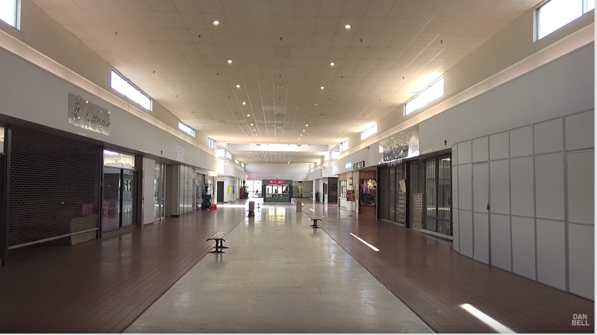 A frame from filmmaker Dan Bell's YouTube video shows empty storefronts lining a corridor at the abandoned Tri-State Mall in Claymont, Delaware, on April 29, 2015.