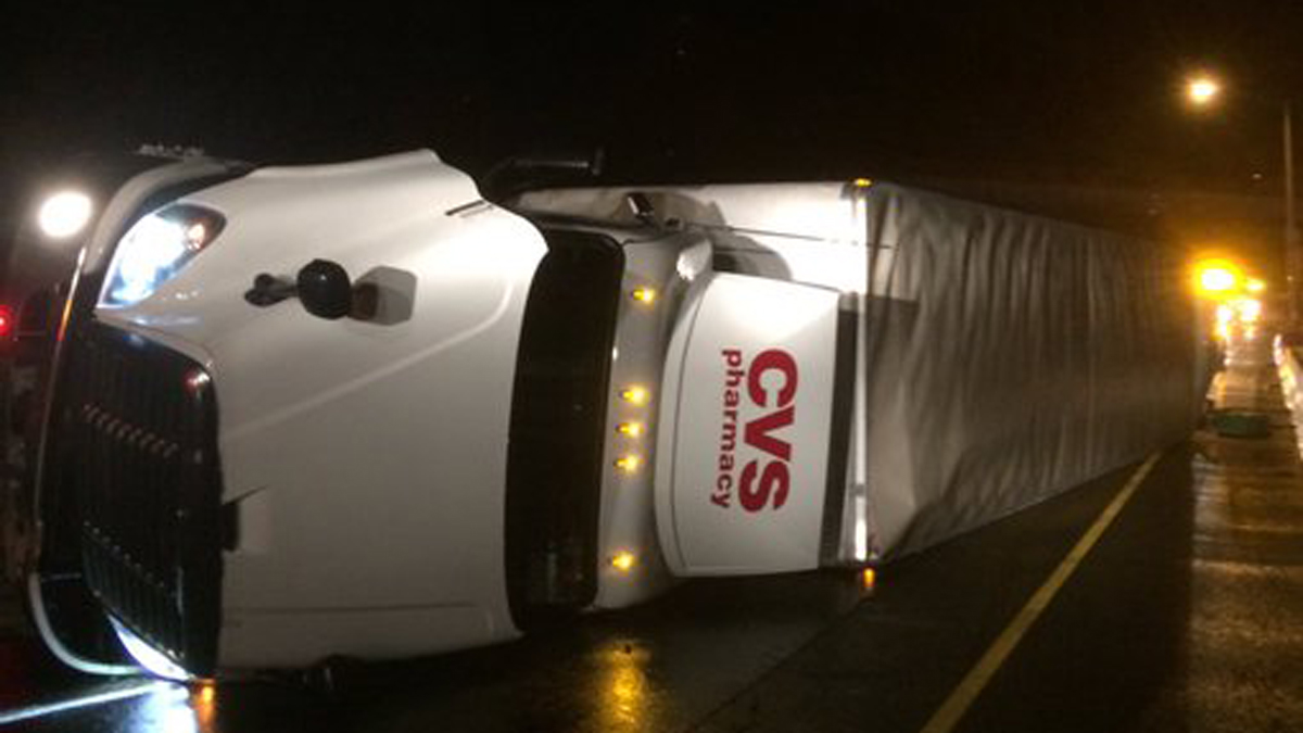 A tractor trailer rollover caused closures on I-84 west in Danbury Wednesday morning.