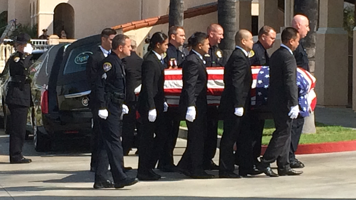 Flag-draped coffin carrying SDPD Officer Jonathan De Guzman arrives for the public memorial on Friday, Aug. 5, 2016.