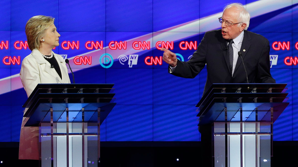 Democratic presidential candidates Sen. Bernie Sanders, I-Vt., right, and Hillary Clinton speak during the CNN Democratic Presidential Primary Debate at the Brooklyn Navy Yard on Thursday, April 14, 2016 in New York.