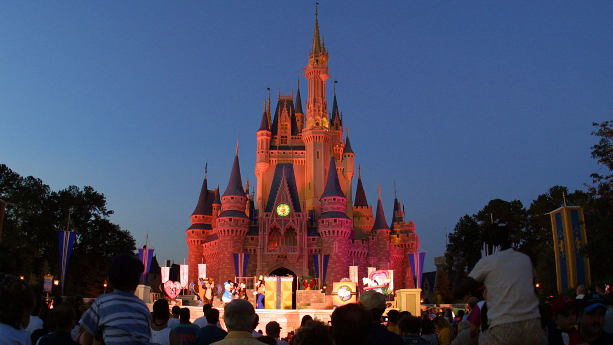 People watch a show on stage in front of Cinderella's castle at Walt Disney World's Magic Kingdom in Orlando, Florida.