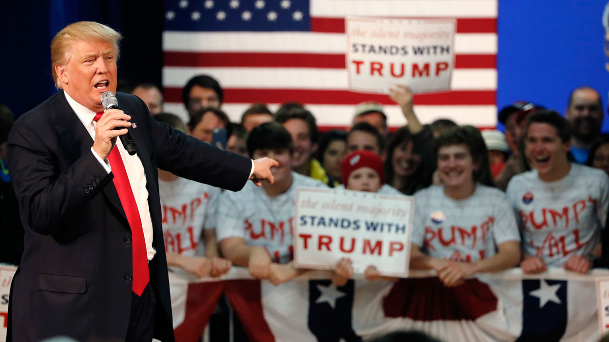 Republican presidential candidate, Donald Trump, acknowledges the young people behind him at a town hall Saturday, April 2, 2016, in Rothschild, Wis.