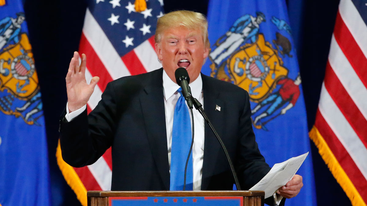 Republican presidential candidate, Donald Trump, reads The Snake poem during a rally at Nathan Hale High School, Sunday, April 3, 2016, in West Allis, Wis.