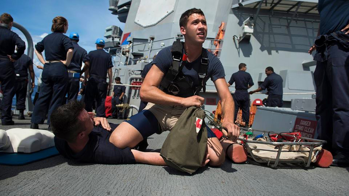 Electronics Technician 3rd Class Dustin Doyon provides first aid assistance during seamanship drills while serving as Search and Rescue (SAR) Swimmer onboard the Arleigh Burke-class missile-guided destroyer USS John S. McCain (DDG 56).
