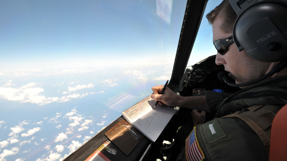 U.S. Navy LT JG Curtis Calabrese takes notes on board of a U.S. Navy Lockheed P-3C Orion patrol aircraft from Sigonella, Sicily, on May 22, 2016, searching the area where the Egyptair flight 804 went missing on May 19. Investigators have located signals that could lead to the location of the wreckage.