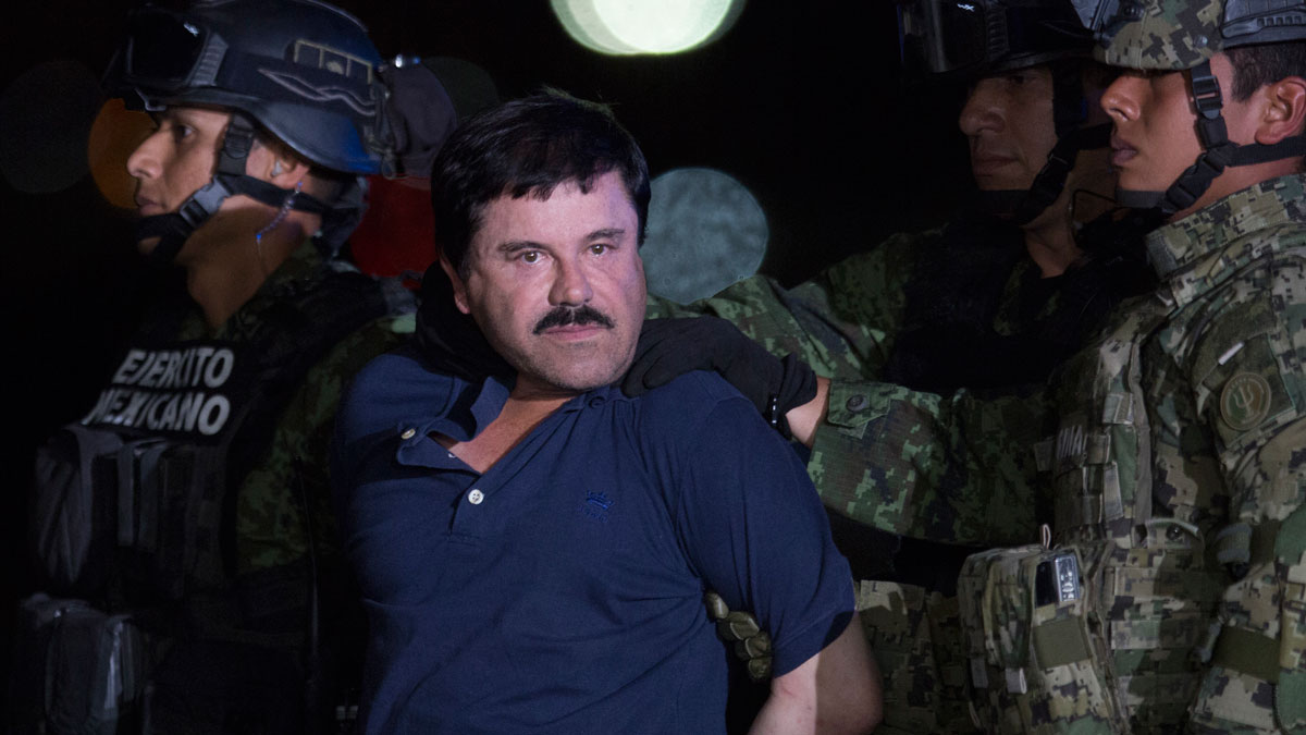 File image of Joaquin 'El Chapo' Guzman being escorted after President of Mexico Enrique Peña Nieto announced his detention on January 08, 2016 in Mexico City, Mexico.
