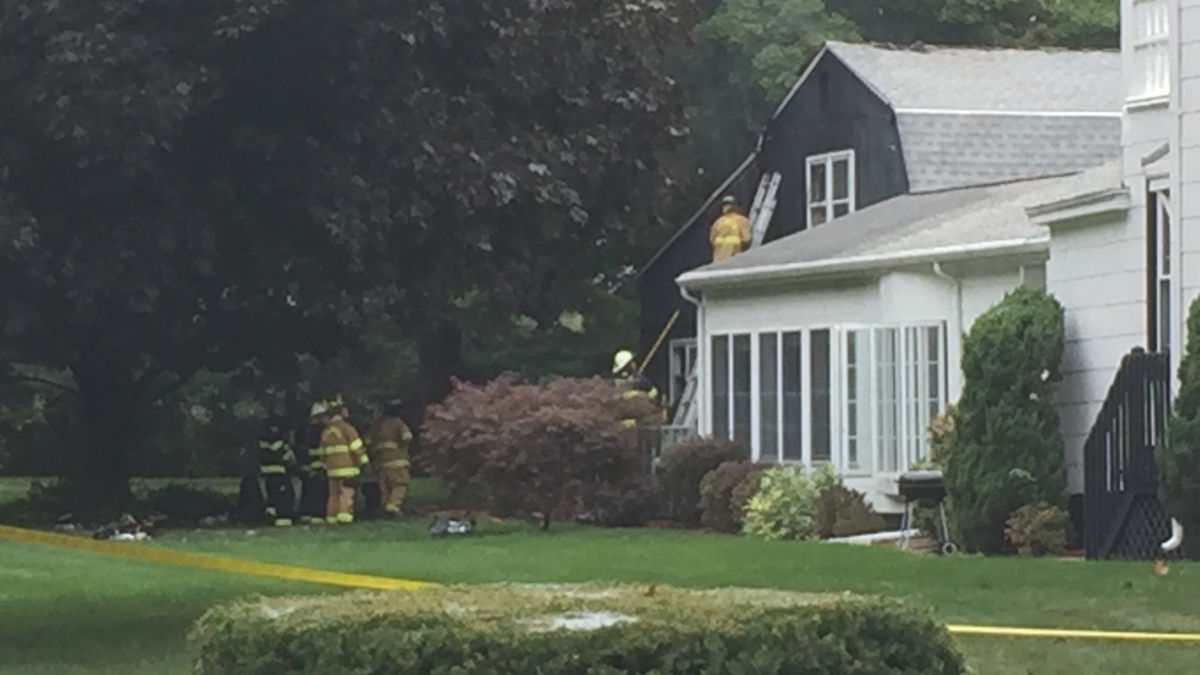 Crews on scene at a house fire on Maple Street in Ellington Sunday.