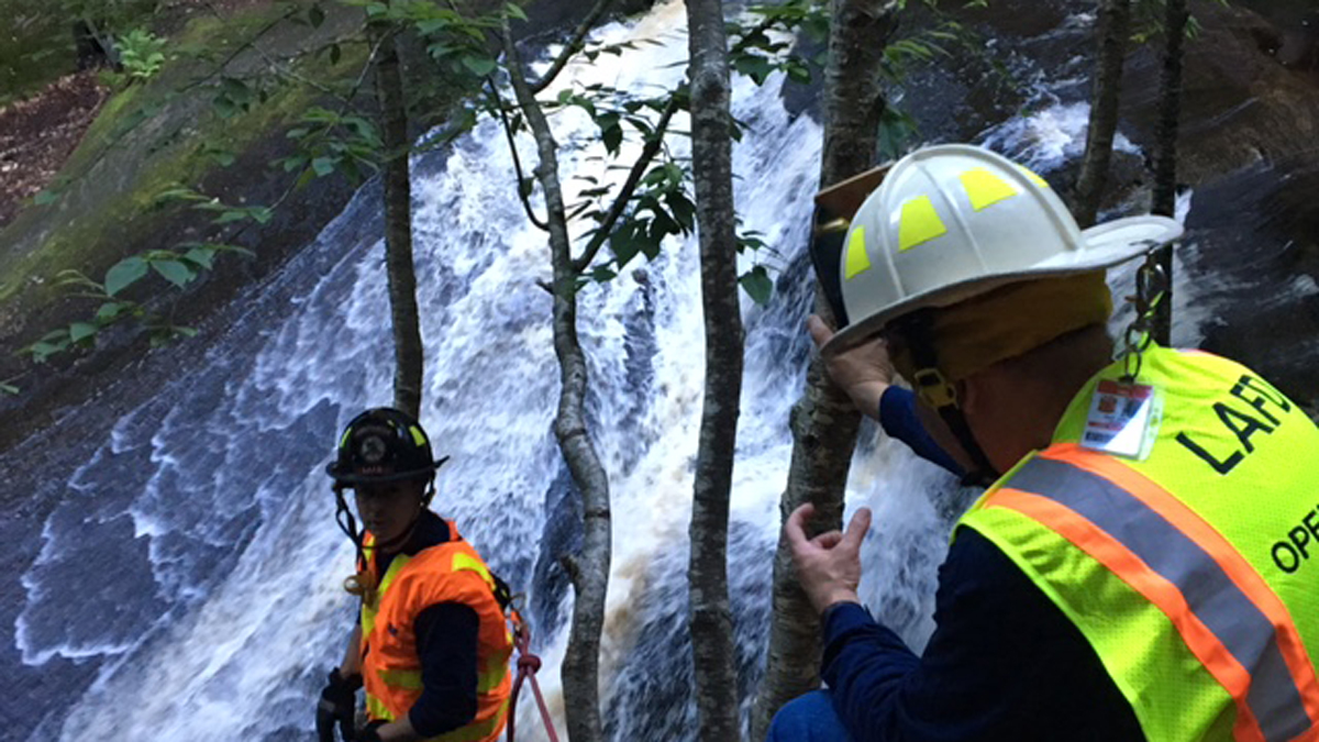 First responders train for technical rescue operations at the falls at Enders State Forest in Granby.