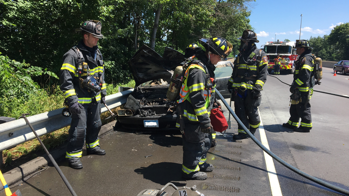 A witness and a conversation police officer pulled a driver to safety after he car caught fire following a crash on I-95 in Fairfield Wednesday.