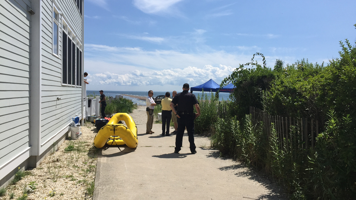 Rescue crews are searching off the coast of Fairfield for two men who were swept out into the water while fishing at Penfield Reef Saturday.