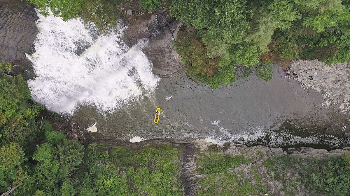 Crews search for a missing swimmer in Falls Creek on Saturday.