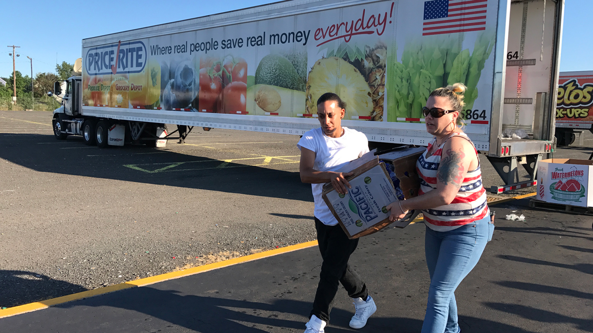 Volunteers from Feed the Children teamed up with PepsiCo and PriceRite Supermarkets to provide 40 pounds of food for each family in need.