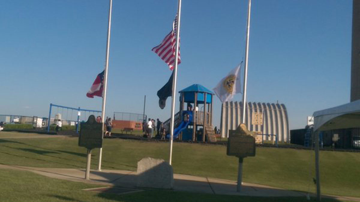 Flags fly at half-staff at the DeKalb-Peachtree airport after a pilot was killed during a stunt at an annual air show.