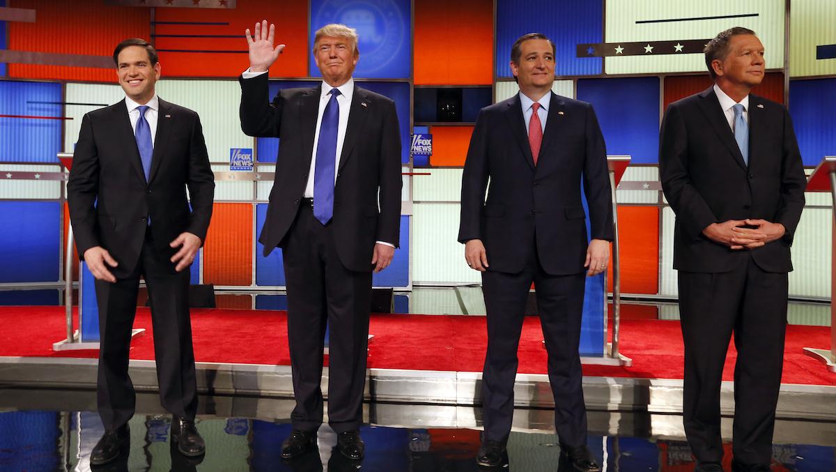 Republican presidential candidates, Sen. Marco Rubio, R-Fla., businessman Donald Trump, Sen. Ted Cruz, R-Texas, and Ohio Gov. John Kasich take the stage before a Republican presidential primary debate at Fox Theatre, Thursday, March 3, 2016, in Detroit.