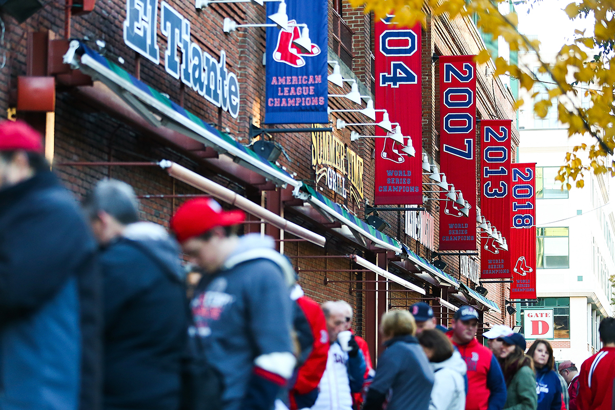 Fans line up under the Boston Red Sox World Series banners before the Boston Red Sox 2018 World Series parade outside of Fenway Park on Oct. 31, 2018, in Boston.