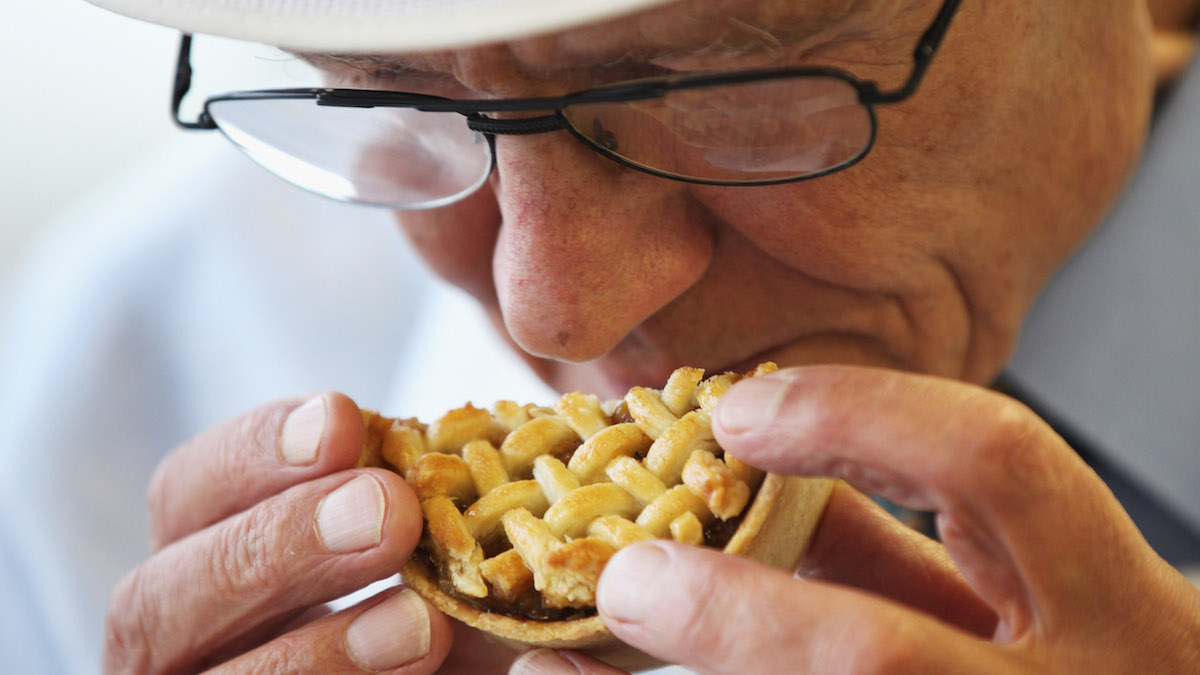 In this file photo, A judges smells a pie as judging takes place in the World Scotch Pie Championship on November 16, 2010. Researchers at the University of California, Berkeley, found that mice that retained their sense of smell ballooned to twice their normal weight by eating the same amount of fatty food as the mice with no sense of smell.