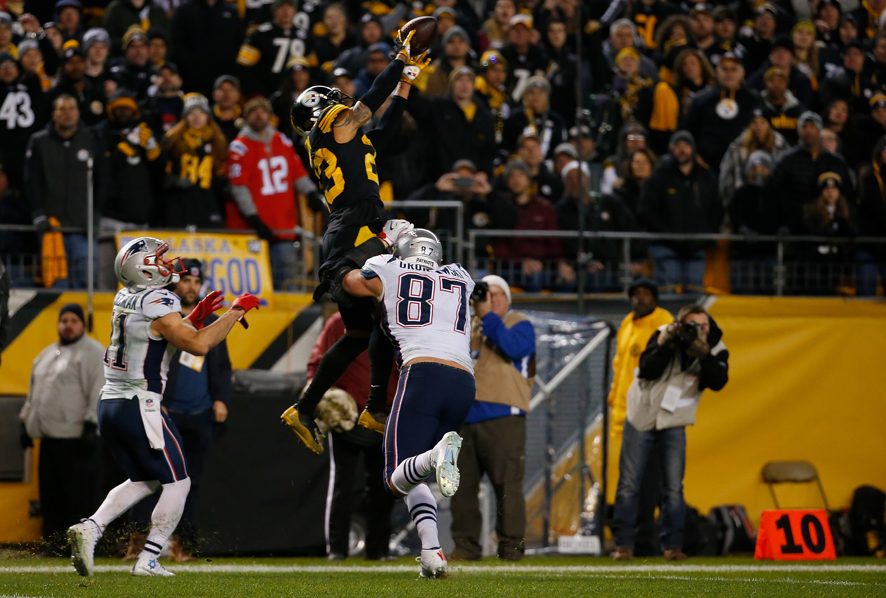PITTSBURGH, PA - DECEMBER 16: Joe Haden #23 of the Pittsburgh Steelers intercepts a pass intended for Julian Edelman #11 of the New England Patriots in the fourth quarter during the game at Heinz Field on December 16, 2018 in Pittsburgh, Pennsylvania. (Photo by Justin K. Aller/Getty Images)