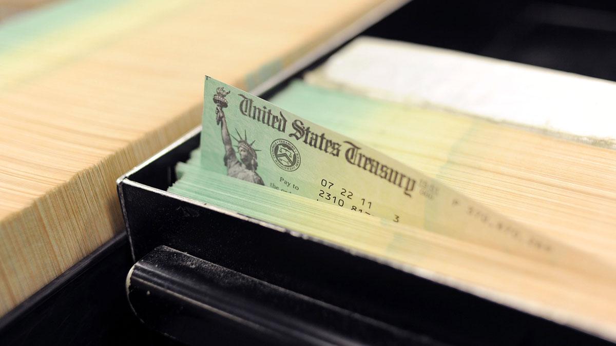 In this photo illustration U.S. Treasury checks are piled at the U.S. Treasury printing facility in Philadelphia, Pennsylvania.