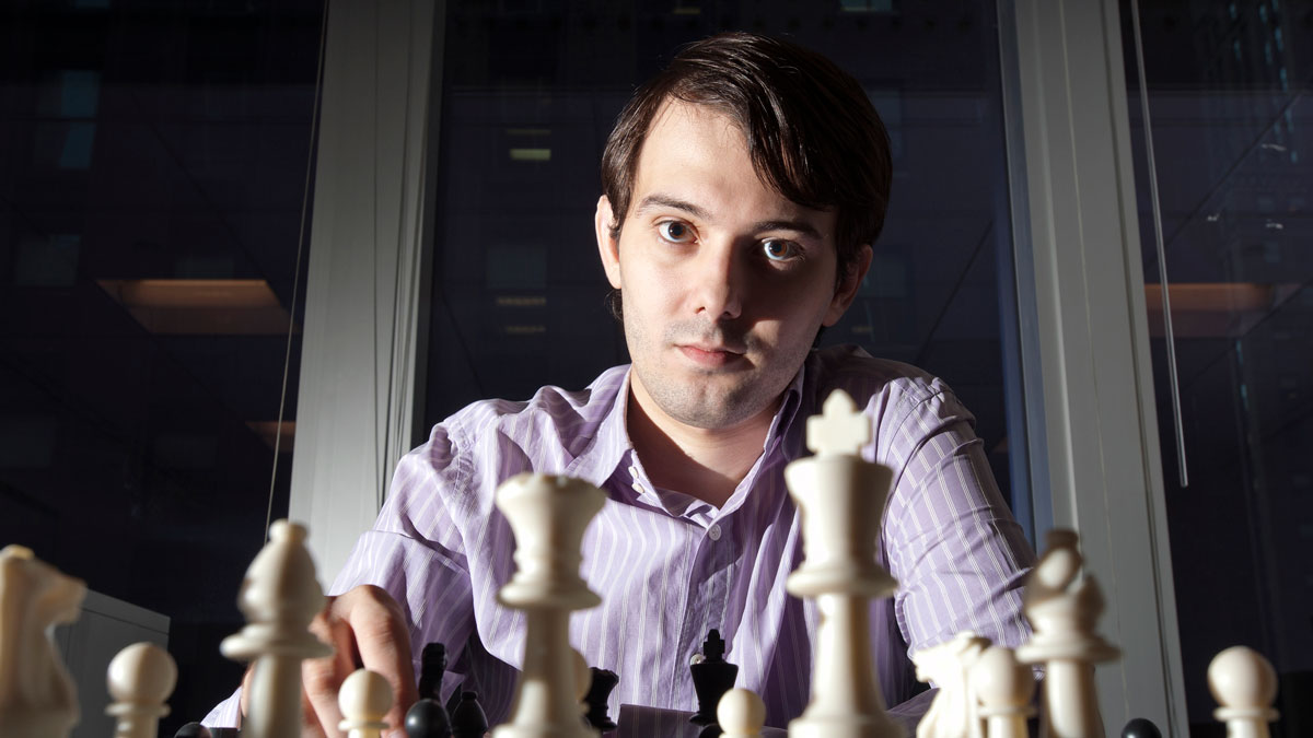 Martin Shkreli, chief investment officer of MSMB Capital Management, sits for a photograph behind a chess board in this file photo.