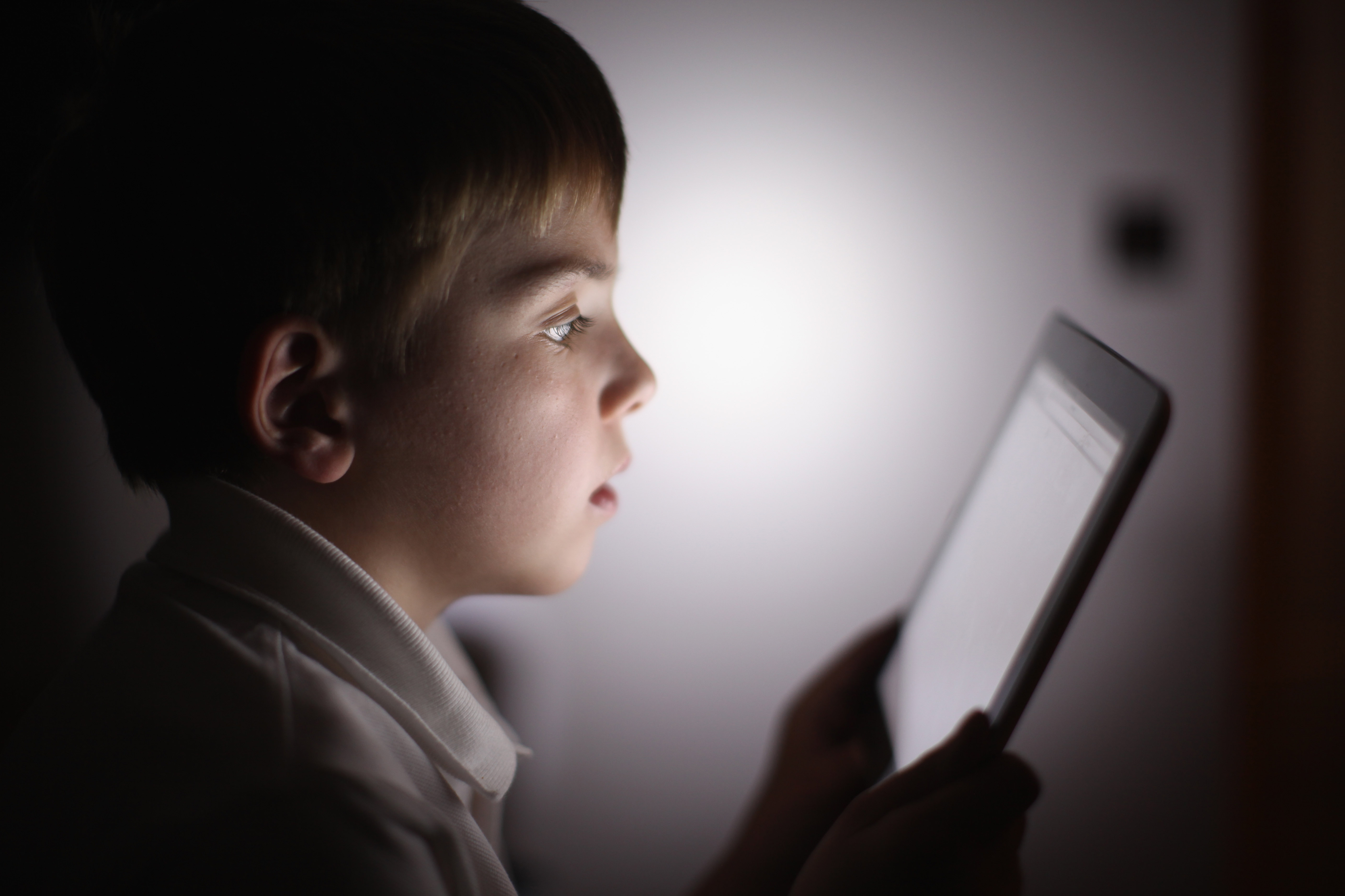 In this file photo, a ten-year-old boy uses an Apple iPad tablet computer on November 29, 2011. New guidelines by the AAP recommend that parents show young children high quality, educational programming, such as Sesame Street.