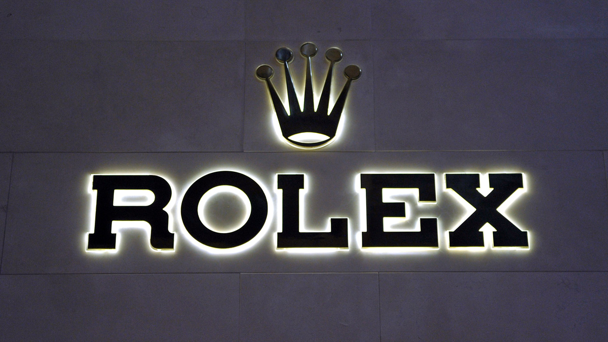 BASEL, SWITZERLAND - MARCH 13:  A Rolex logo is displayed at BASELWORLD 2012 - The World Watch And Jewellery Show on March 13, 2012 in Basel, Switzerland.  (Photo by The Image Gate/Getty Images)