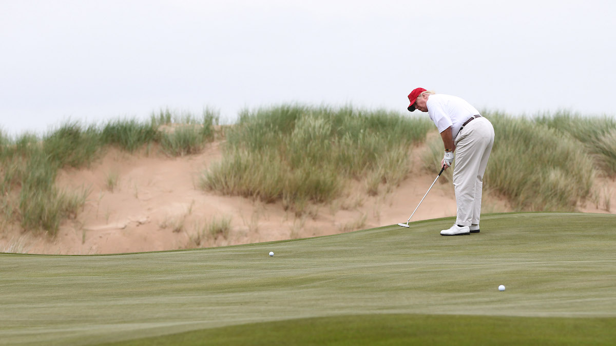 In this file photo, Donald Trump plays a round of golf after the opening of The Trump International Golf Links Course in Balmedie on July 10, 2012, in Balmedie, Scotland. His frequent trips to the golf course as president have become a point of controversy.
