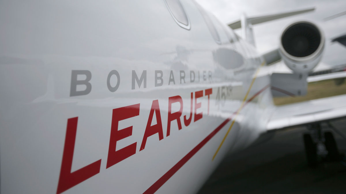 FILE-A logo sits on the side of a Learjet 45XR aircraft
