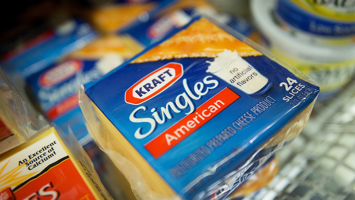 File - Kraft Foods Group Inc. Singles cheese slices are displayed in a supermarket in New York, U.S., on Monday, Nov. 5, 2012.