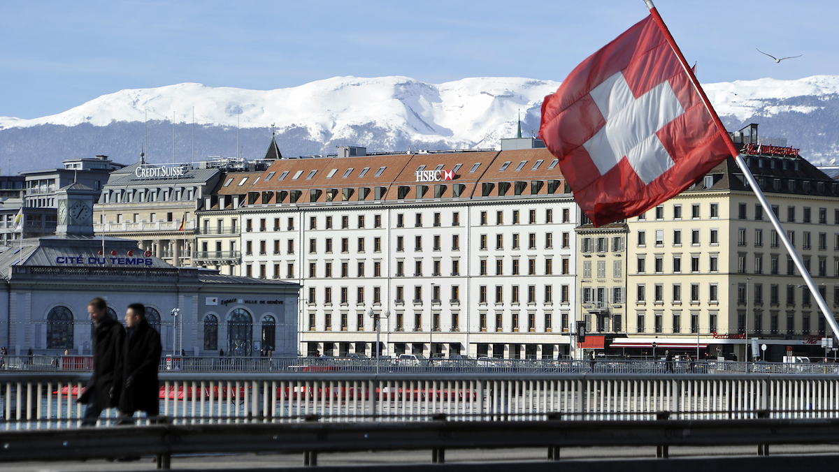 In this file photo, a Swiss flag flies above a HSBC logo is seen on HSBC offices on February 9, 2015 in Geneva, Switzerland.