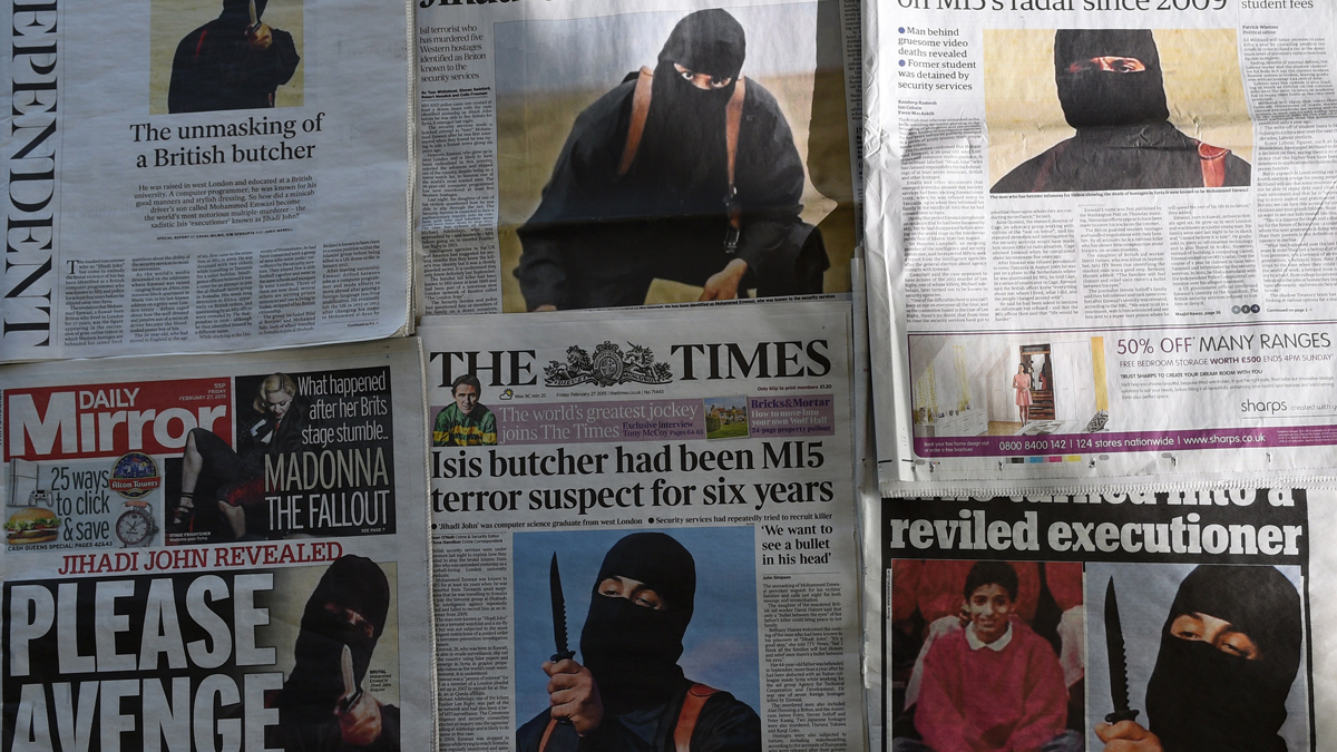 An arrangement of British daily newspapers photographed in London on February 27, 2015, shows the front-page headlines and stories regarding the identification of the masked Islamic State group militant dubbed