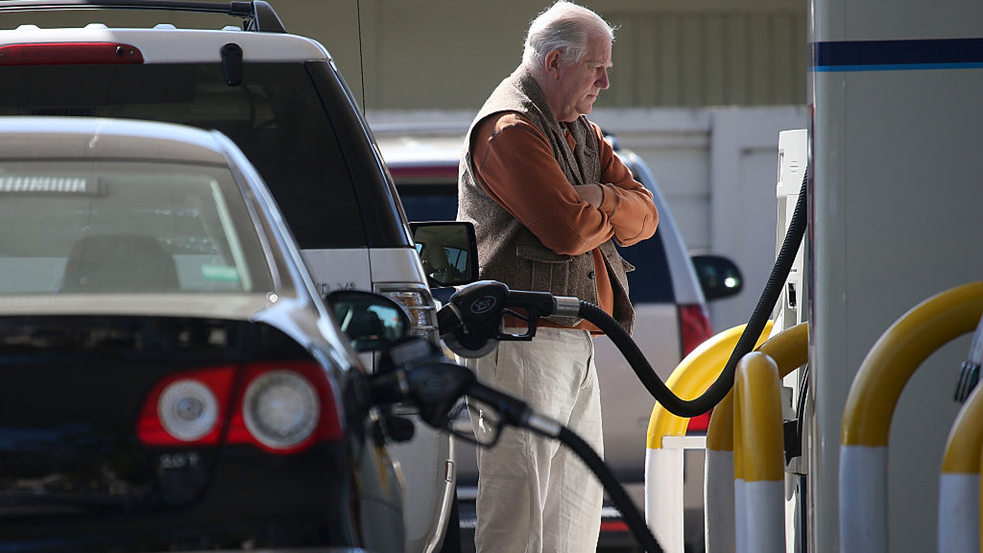A customer pumps gasoline into his car at an Arco gas station in Mill Valley.