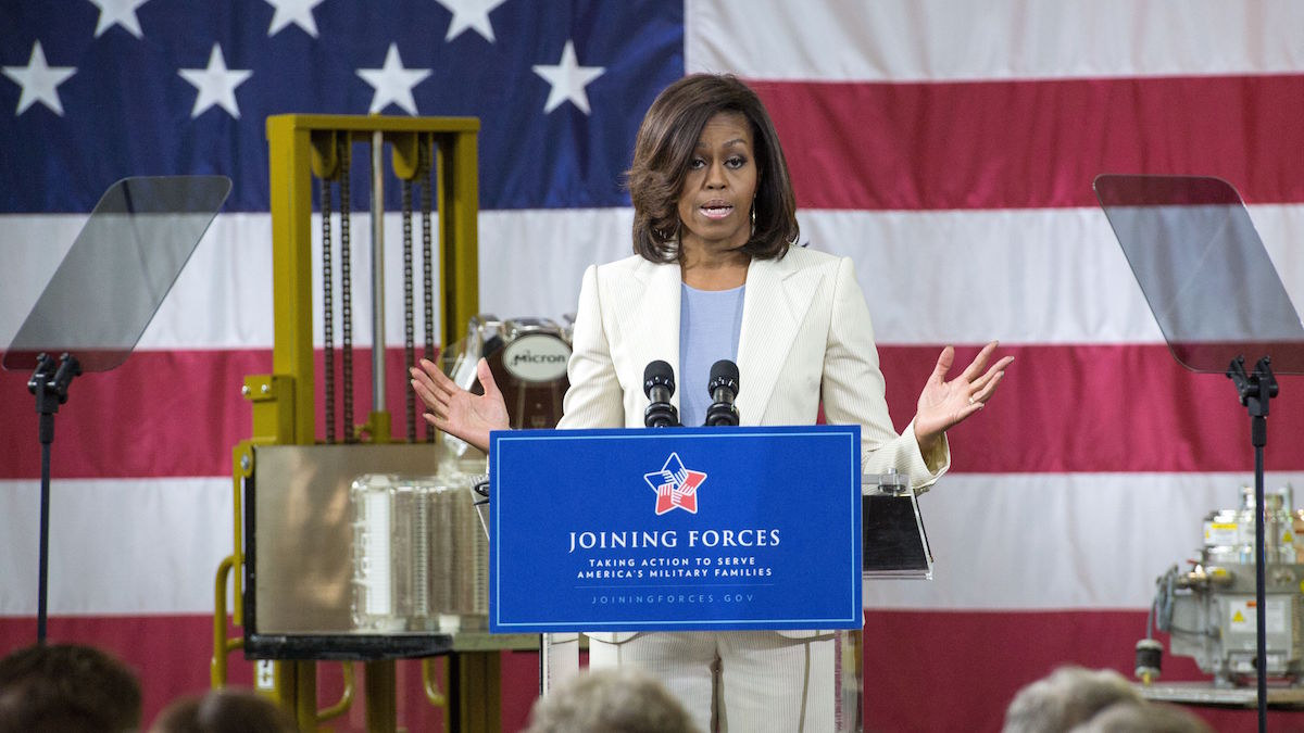 File -First Lady Michelle Obama speaks about the Joining Forces initiative, calling on Americans to rally around service members, veterans, and their families, April 23, 2015 while visiting the Micron Technology factory in Manassas, Virginia. Since its launch in 2011, more than 1.2 million veterans have been hire by the private sector.