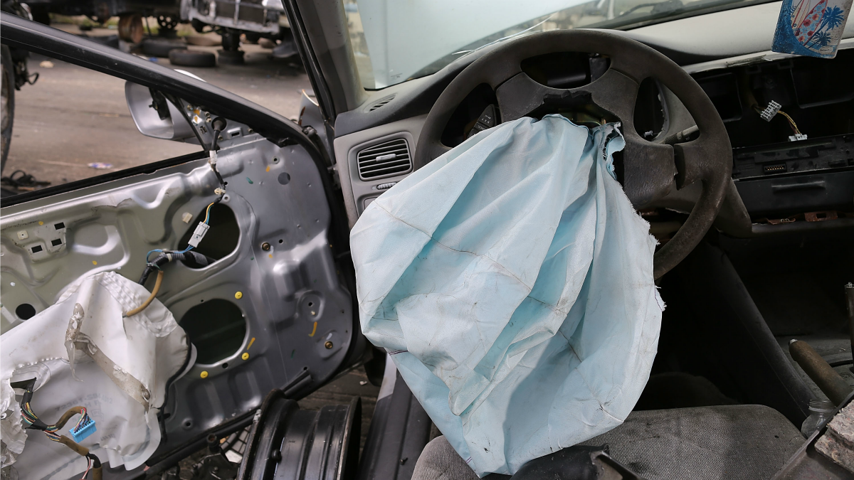 A deployed Takata airbag sits in a Florida salvage yard.
