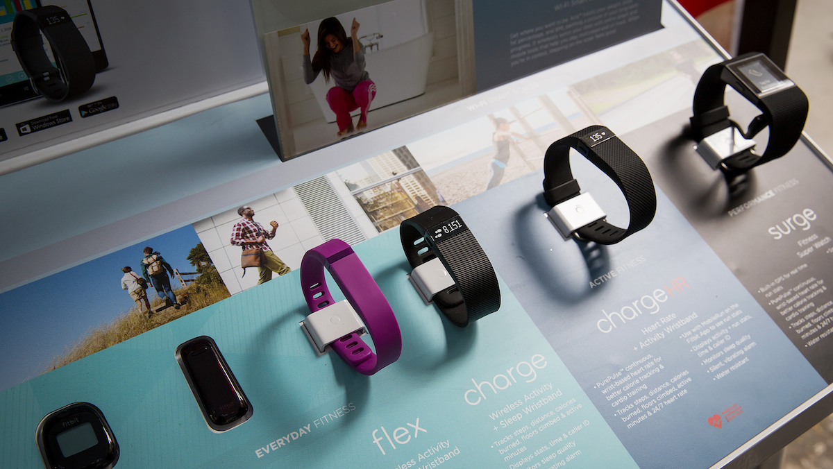 In this file photo, Fitbit products are displayed during a workout event.