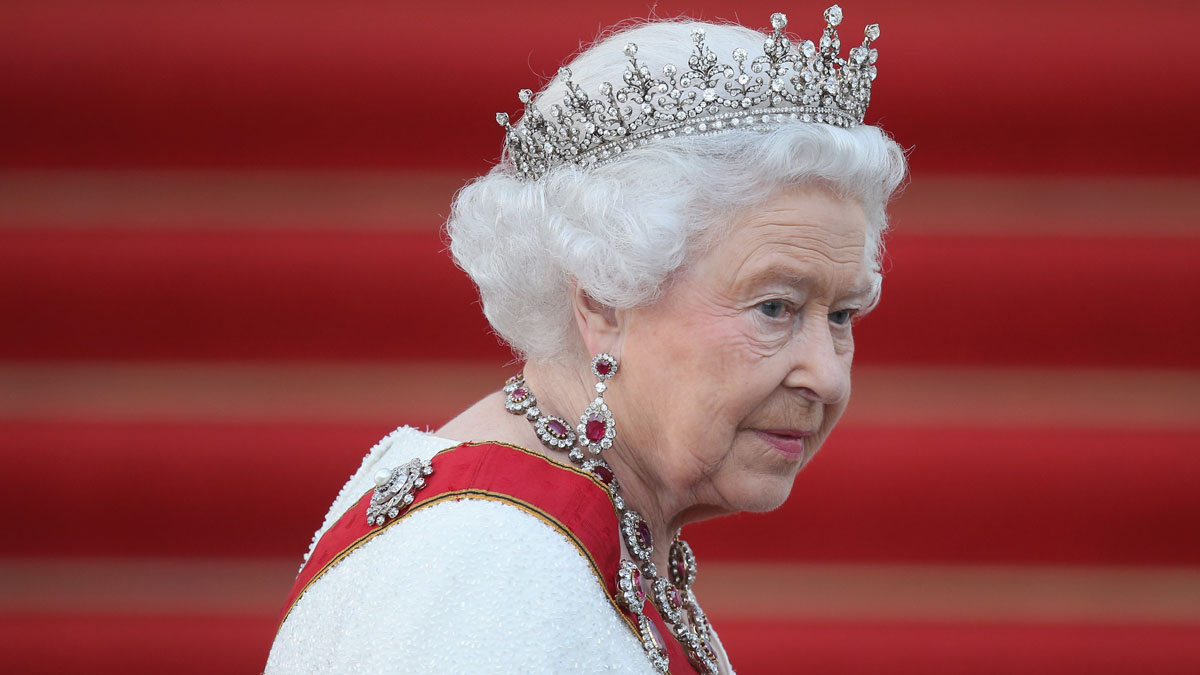 In this June 24, 2015, photo, Queen Elizabeth II arrives for the state banquet in her honor at Schloss Bellevue palace on the second of the royal couple's four-day visit to Germany in Berlin, Germany.