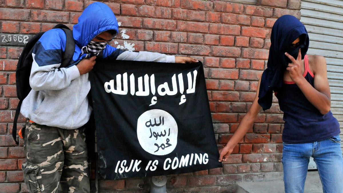 FILE-Kashmiri protesters displaying the flags of ISIS during a protest