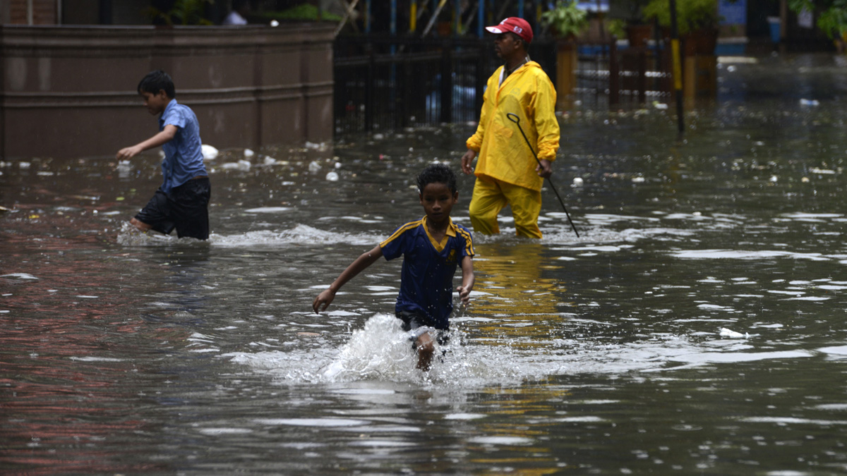 Heavy rains lashed Mumbai city disturbing normal life due to water logging in low lying areas and flooding of railway tracks in the city.