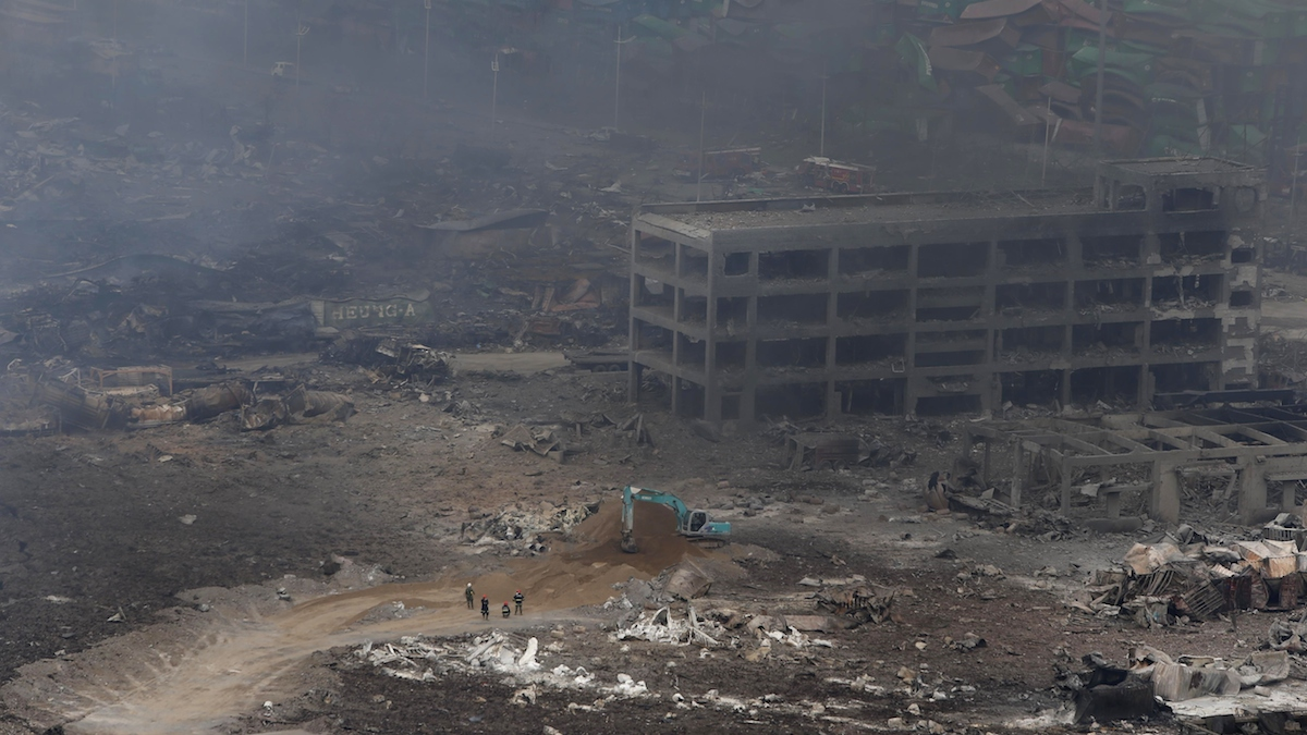 Rescuers work at the site of an explosion in Tianjin on August 14, 2015.