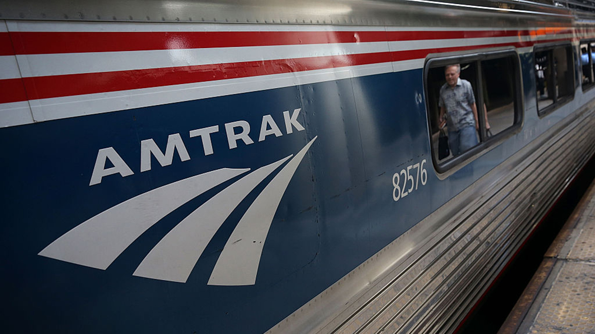 WASHINGTON, DC - SEPTEMBER 03: A passenger passes by an Amtrak train September 3, 2015 at Union Station in Washington, DC. U.S. Secretary of Homeland Security Jeh Johnson held a press availability to discuss Operation Railsafe. (Photo by Alex Wong/Getty Images)
