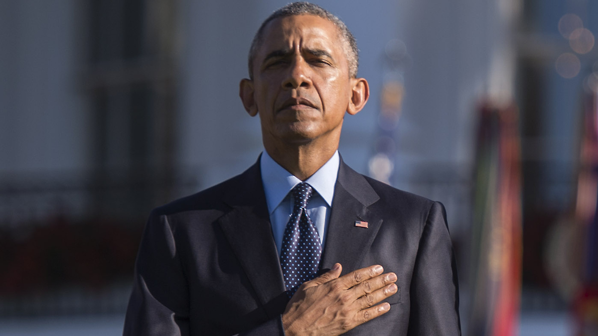 U.S. President Barack Obama stands as Taps is played on the 14th anniversary of the September 11 terrorist attacks on the United States, at the White House on September 11, 2015 in Washington, DC.