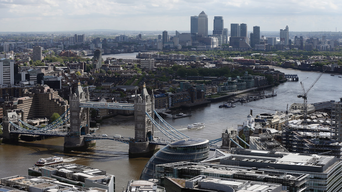 FILE- A general view over Tower Bridge and the River Thames in London, England where the Kleptocracy Tour aims to shed light on where the world's rich and powerful stash their billions.